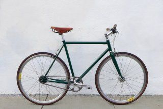 Mission Bicycle - British Racing Green with a Brooks Saddle, Shimano Alfine 8 internal hub, but make it a bullhorn handlebar with a gold rear wheel