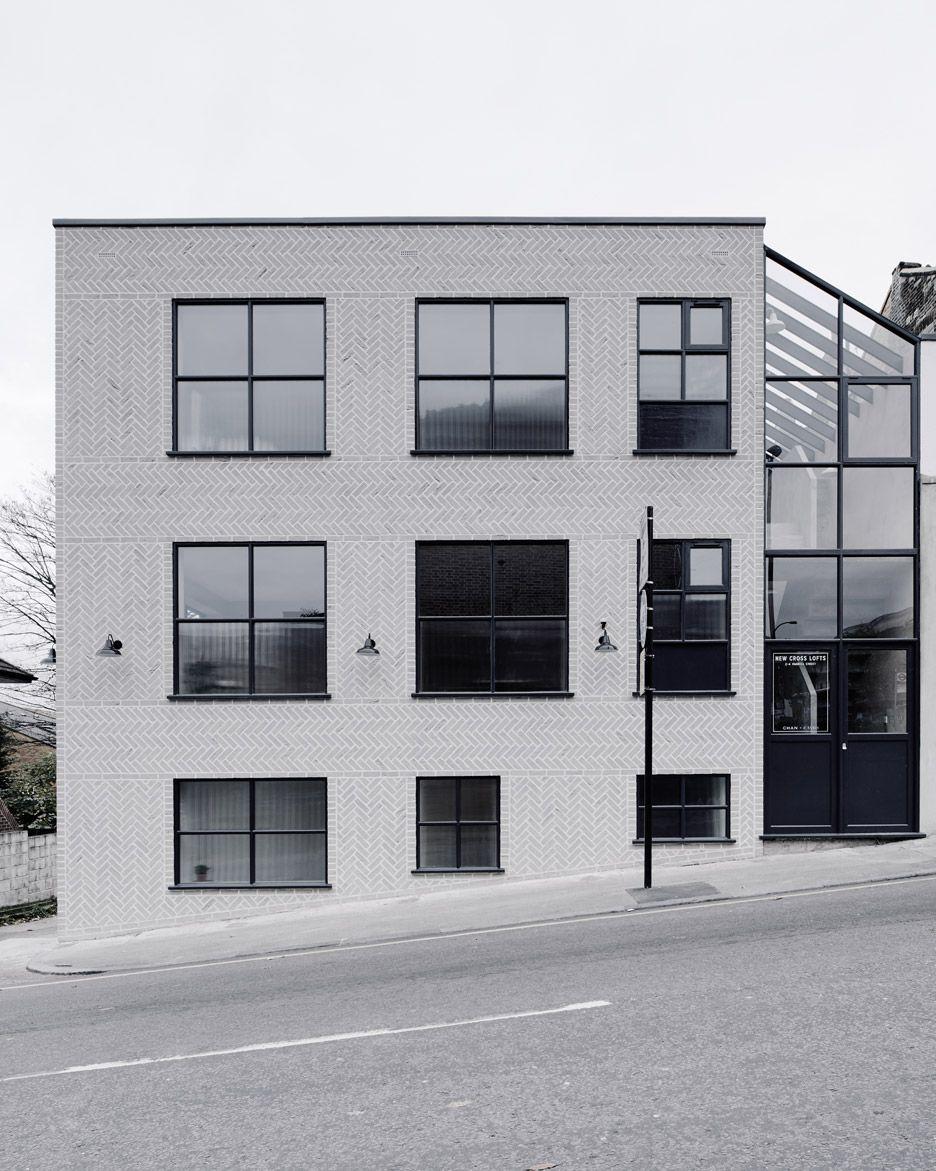 Pale Grey Bricks Are Arranged To Create A Herringbone Pattern