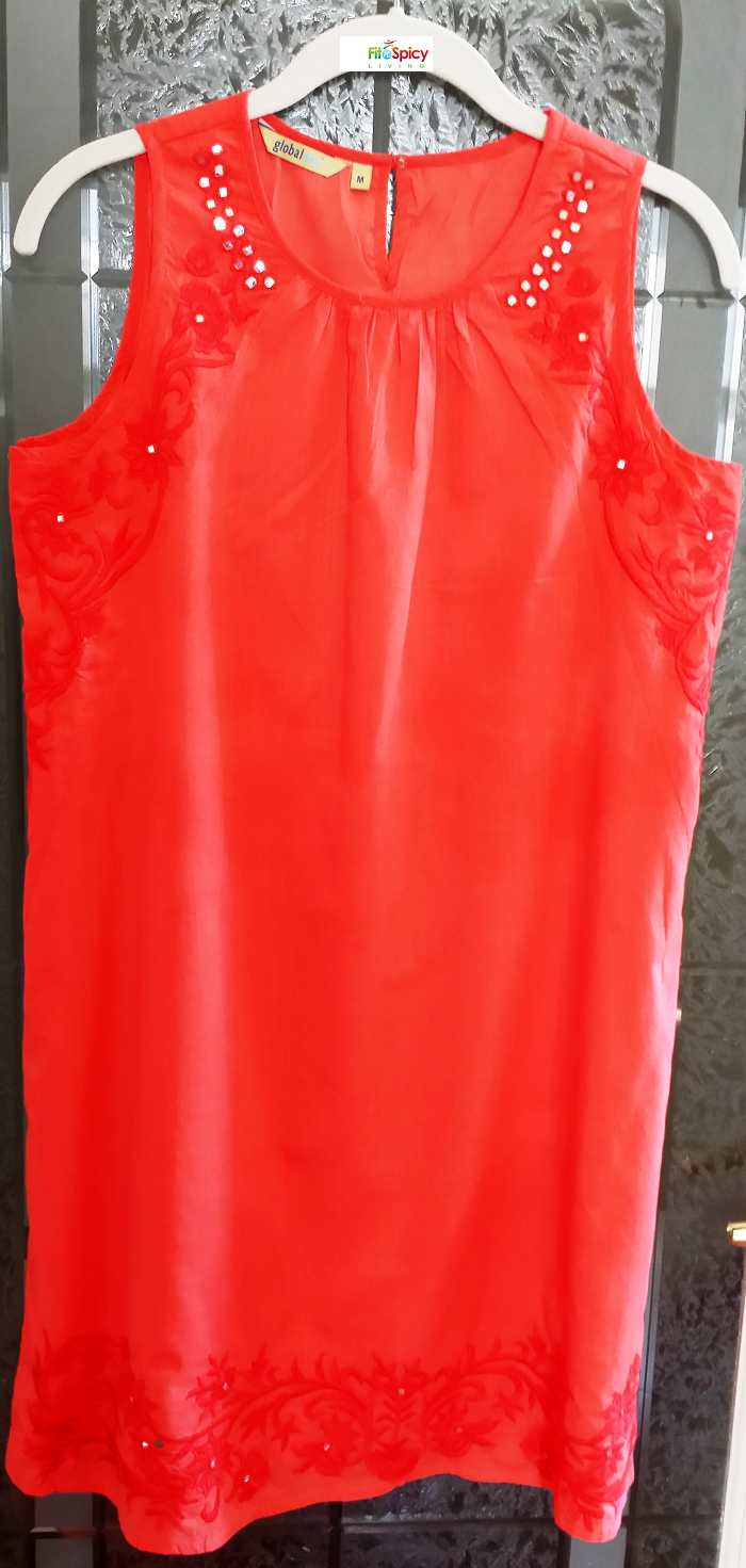 Inexpensive (ready-made / off the rack) cotton kurti from Mumbai - embroidery with tiny mirrors - slightly above knee length - worn over leggings or churidar. Looks good on all body shapes especially those of us blessed with more curves.  Although tailored clothing is the preferred choice in India, there are plenty of ready-made options available. Tailored clothing is cheaper in India than many other countries - benefits are a better fit, custom designs/styles, and your fabric choice.