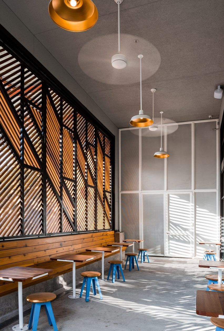 official designs light-filled cafe and dark cocktail bar in dallas
