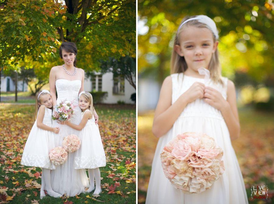 Bride And Flower Girls Pose Flowergirl Holding Peach Tissue Pomander