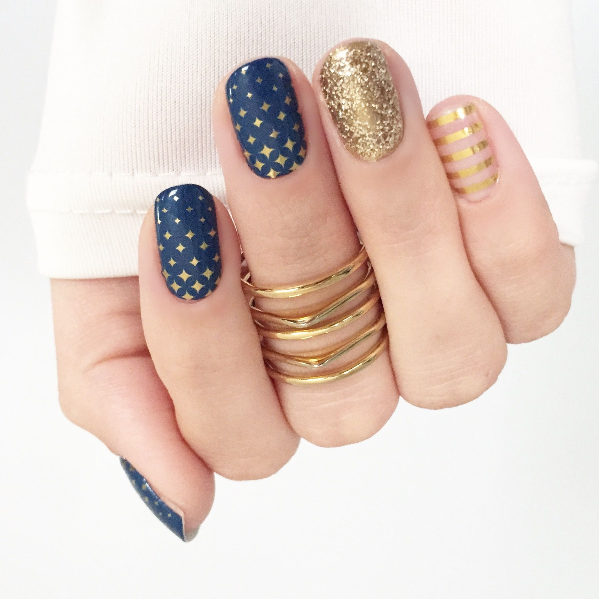 Gold and navy nails dot and stripe nail art jewellery
