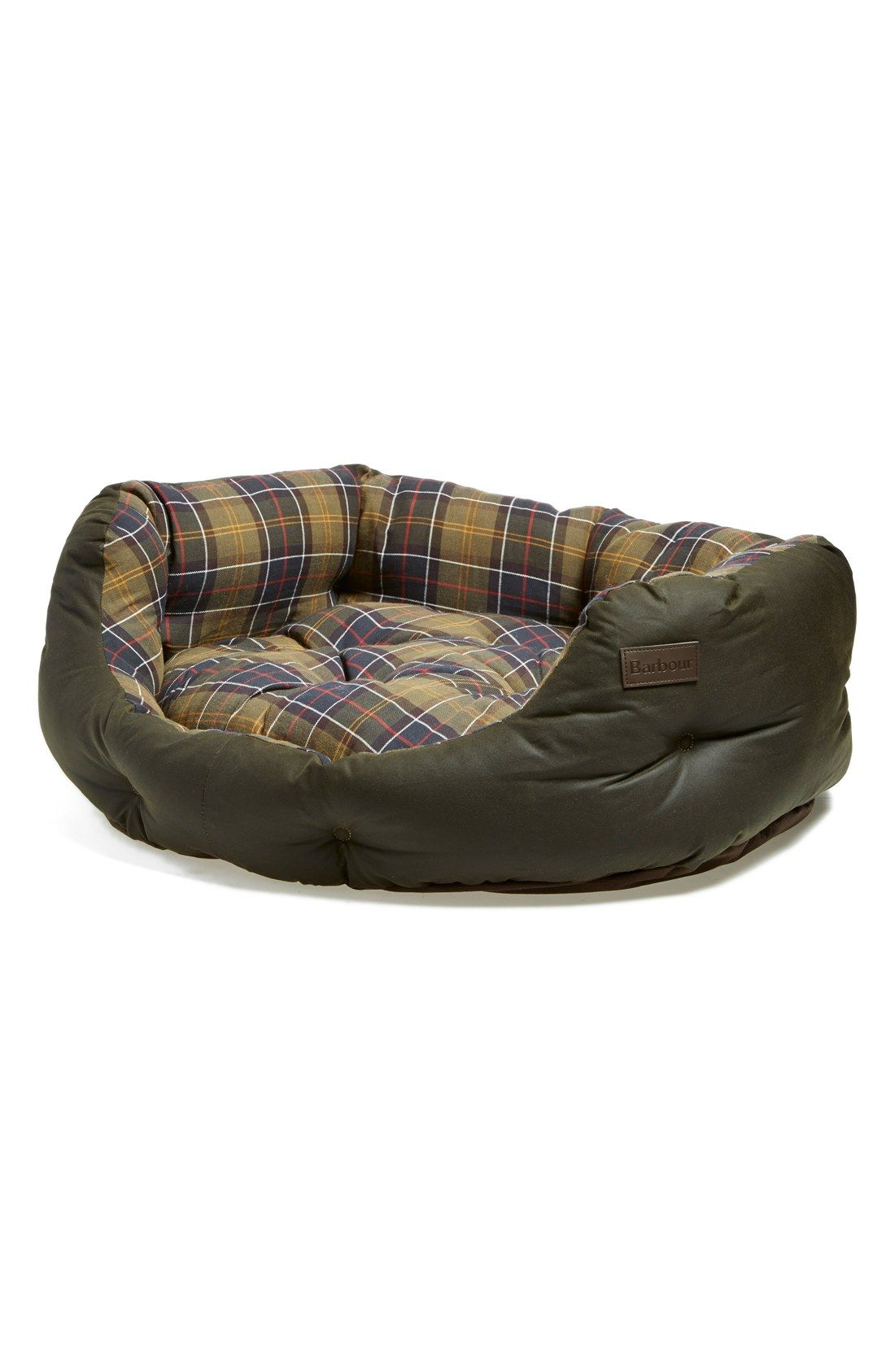 Couldn't forget our furry friend's wishlist! Adoring the sophisticated look this Barbour waxed canvas dog bed has to offer. They'll be snugging, snoring and dreaming in style come Christmas night.