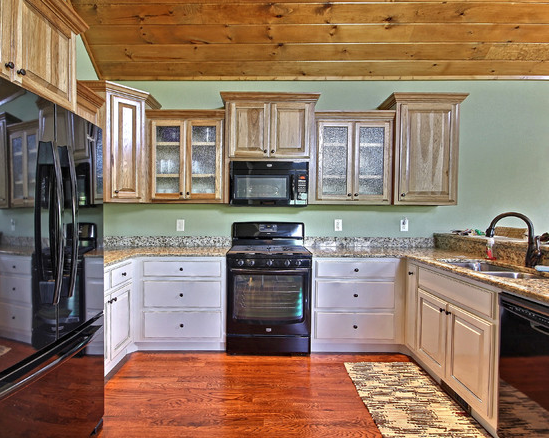 Kitchen inspiration - wood floors, two toned cabinets, new appliances, custom home