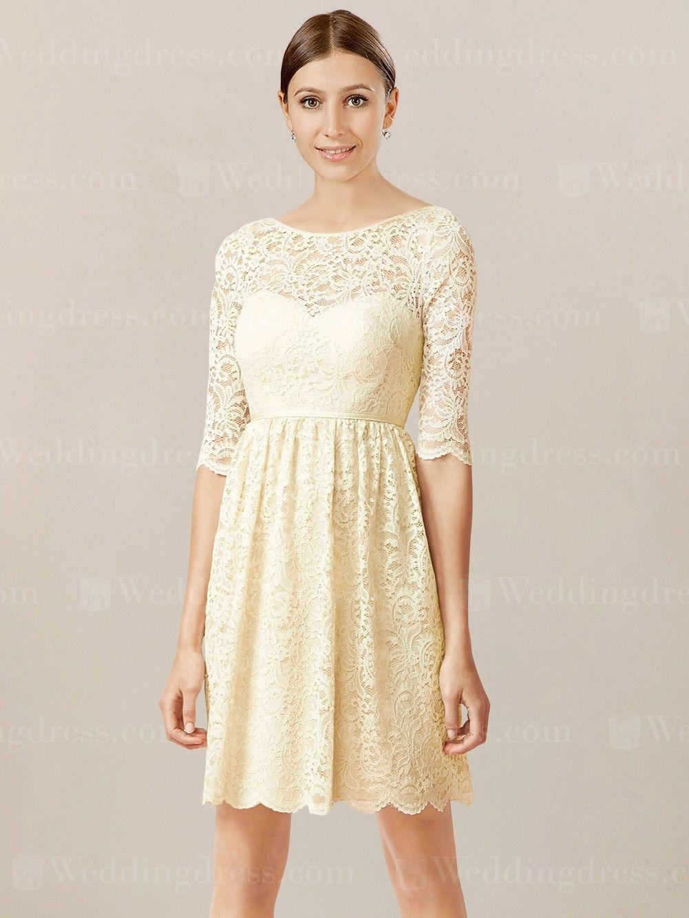 Short lace bridesmaid dress features a bateau neckline over