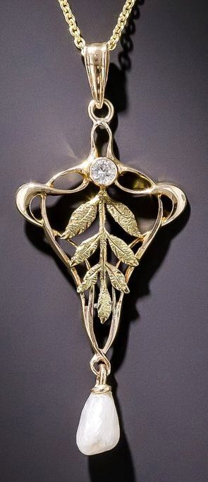 "Art Nouveau Pearl and Diamond Pendant.  A graceful early-20th century Art Nouveau pendant in 10 karat gold, accented with textured green gold leaves, a sparkling diamond and a shimmering freshwater pearl. Measures 1 5/8 inches long by 11/16 inch, suspended from a new 18"" 14 karat yellow gold chain."
