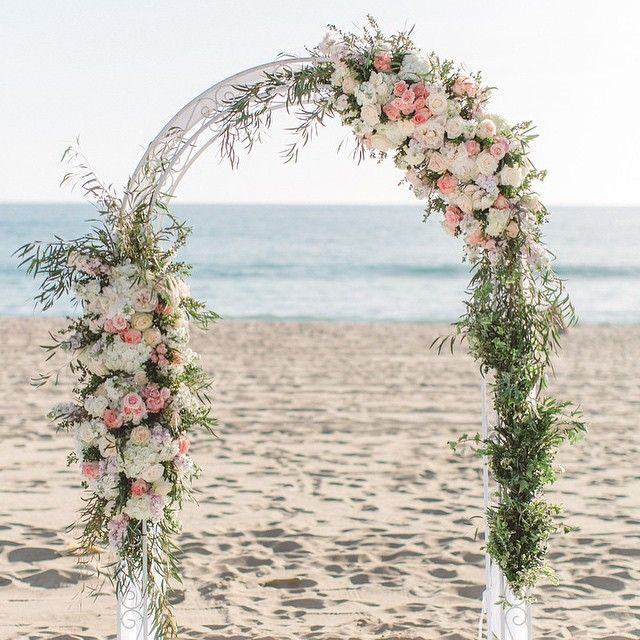 Swooning over this stunning asymmetrical arch by @blossomfloralinc from a wedding we did last month! Photo credit: @annadelores #throwbackthursday #tbt #welovelove #wedding #beach #malibu #ido #ceremony #decor #love #weddingplanner #california #hwsevents