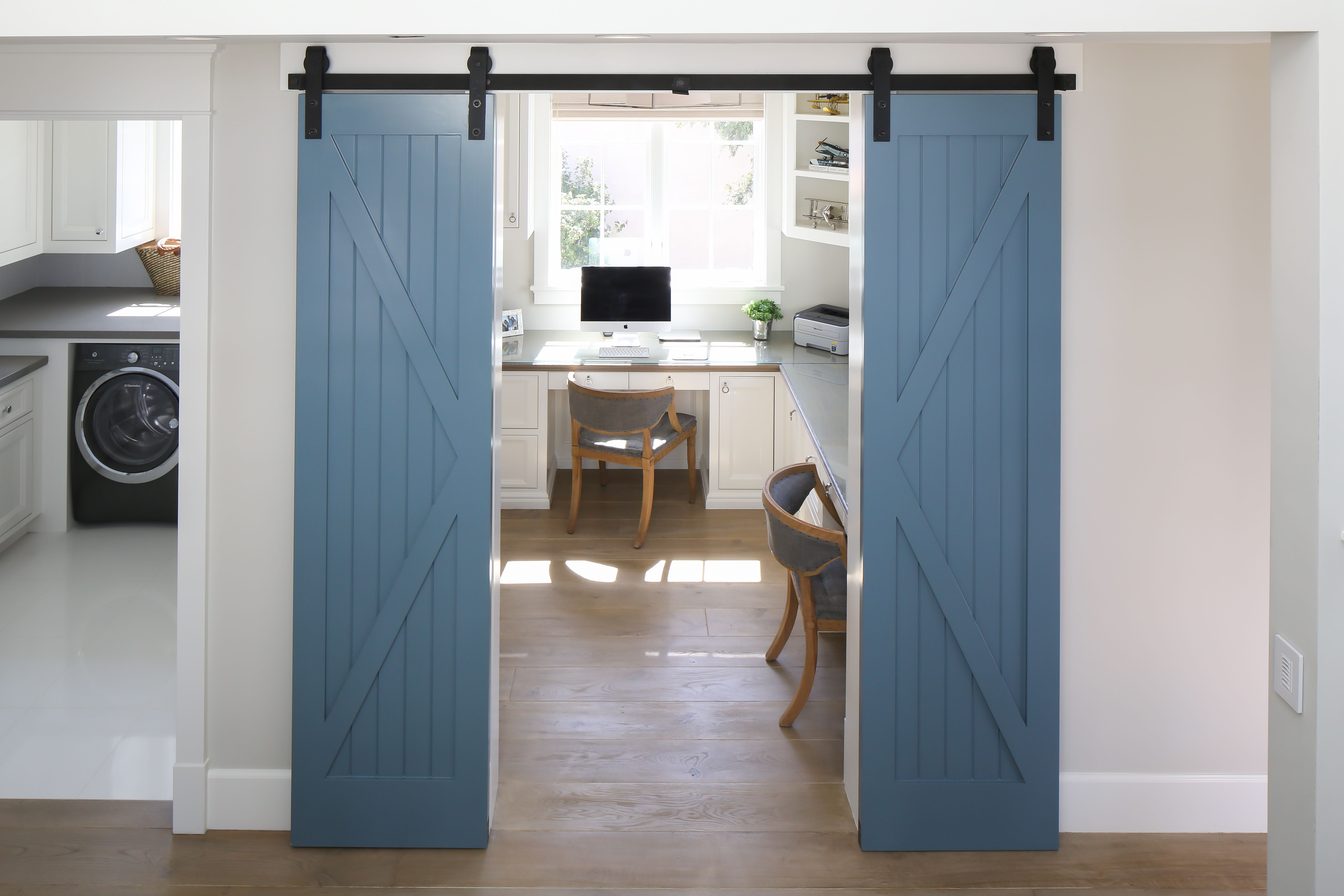 We Love These Thin Blue Sliding Barn Doors They Separate This Home S Office Space From The Hallway In A Very Fash Coastal Living Rooms Home Barn Doors Sliding