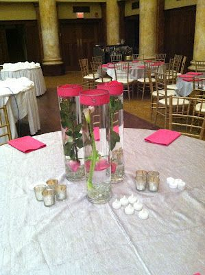 Fuchsia napkins, silver overlays andinteresting centerpieces made for a fun reception.  The LED lights help with the heat in the room when you have as many dancers as this couple did!