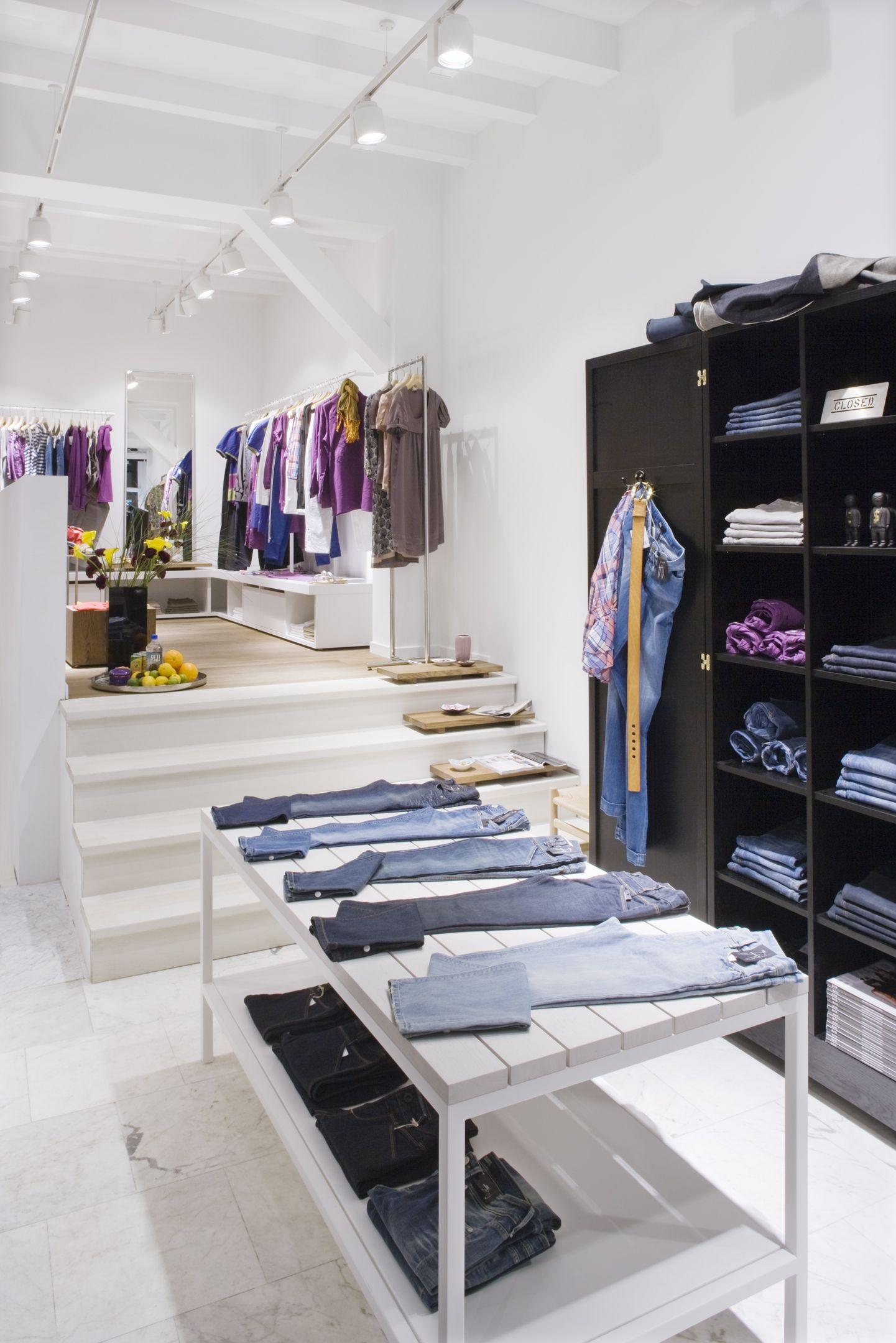 Extensive presentation areas in CLOSED store Amsterdam, Netherlands, with interior design by PHILIPP MAINZER (2007). Photo: Constantin Meyer. #fashion #display #shelf #denim