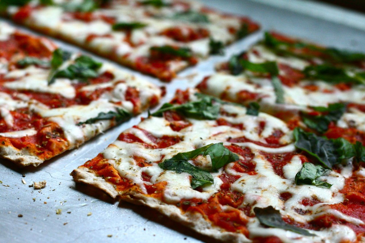 Middle Eastern whole wheat lavash pizza - a recipe for those who want to be skinny mini! Less carbs, light cheese, tomato sauce. A great alternative to traditional Italian pizza.