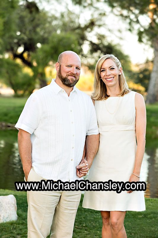 Bride and Groom pose for a formal portrait at La Mariposa Resort wedding venue in Tucson AZ Arizona by Michael Chansley Photography wedding photographer Tucson ideas grass lake pond trees sunset