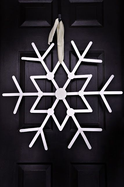 Popsicle Stick Snowflake  Make this pretty snowflake for your door from popsicle sticks.  Get the tutorial on ballardbunch.blogspot.ca