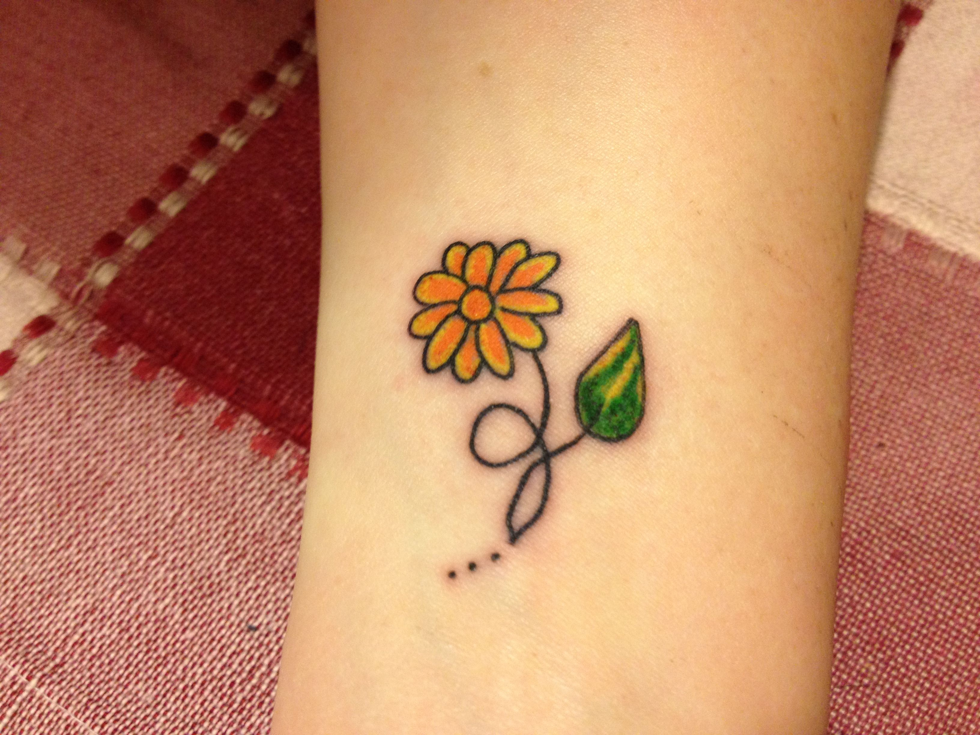 Daisy tattoo in memory of my grandma. Daisy tattoo