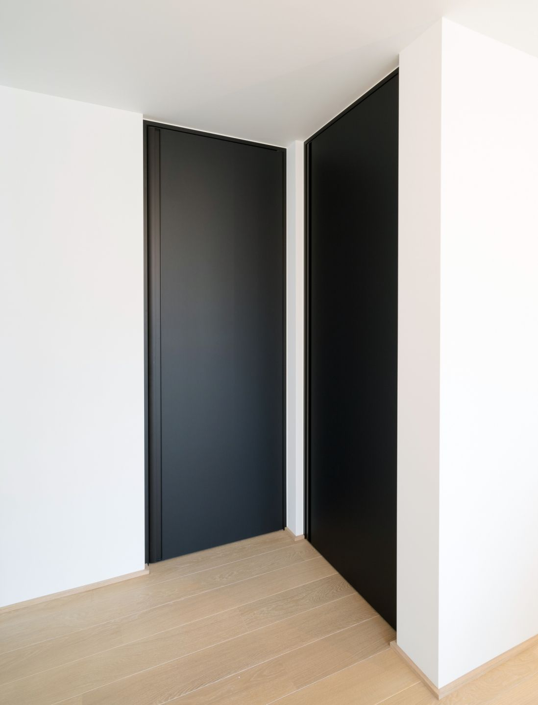 Modern Interior Doors Ideas 14: Modern Black Interior Doors From Floor To Ceiling With An