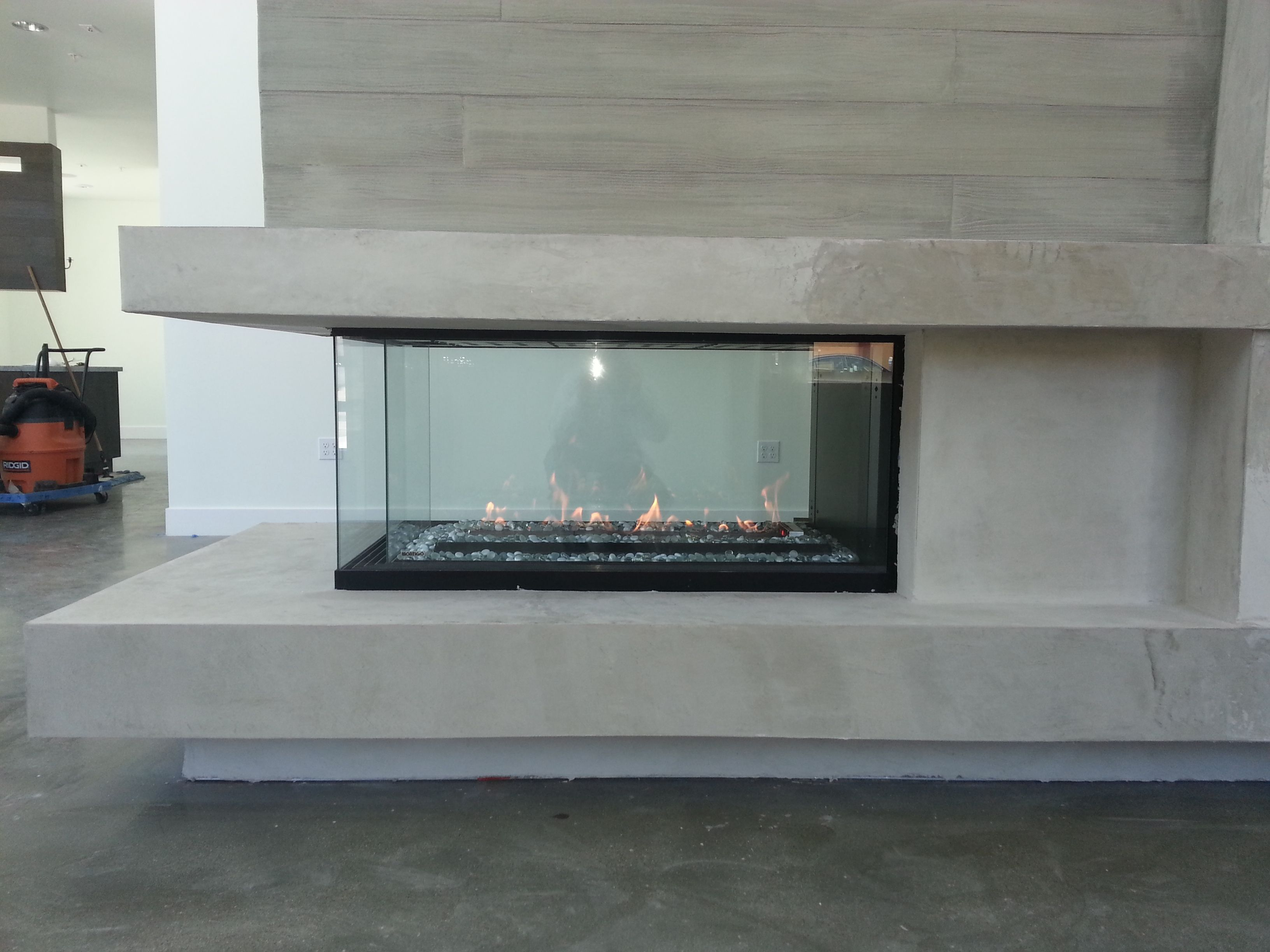 corner and see thru modern fireplace design by the energy house