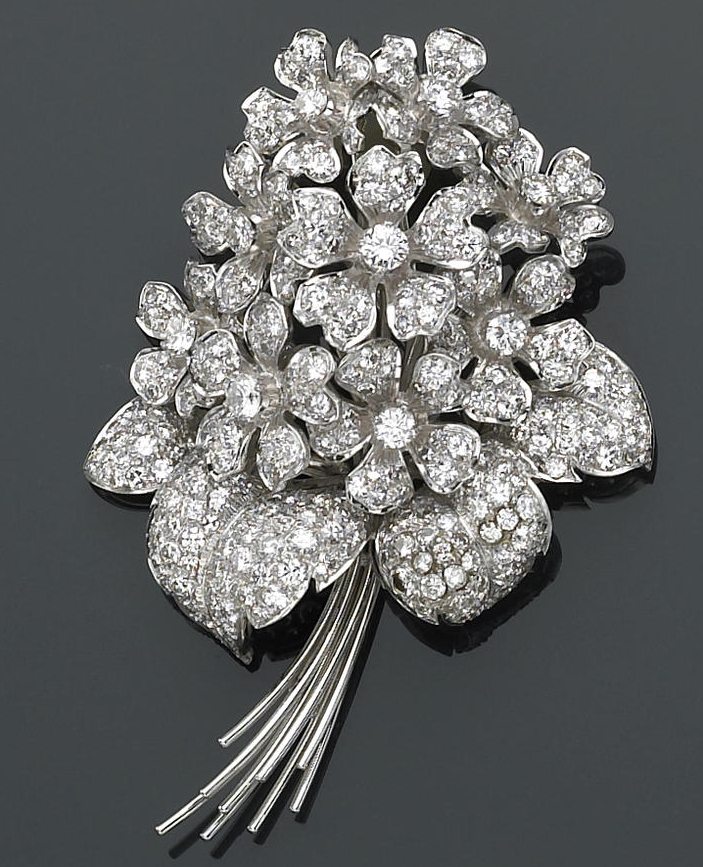 A diamond, platinum and eighteen karat white gold floral brooch  designed as a bouquet of flowers, set throughout with round brilliant and single-cut diamonds; estimated total diamond weight: 9.00 carats.