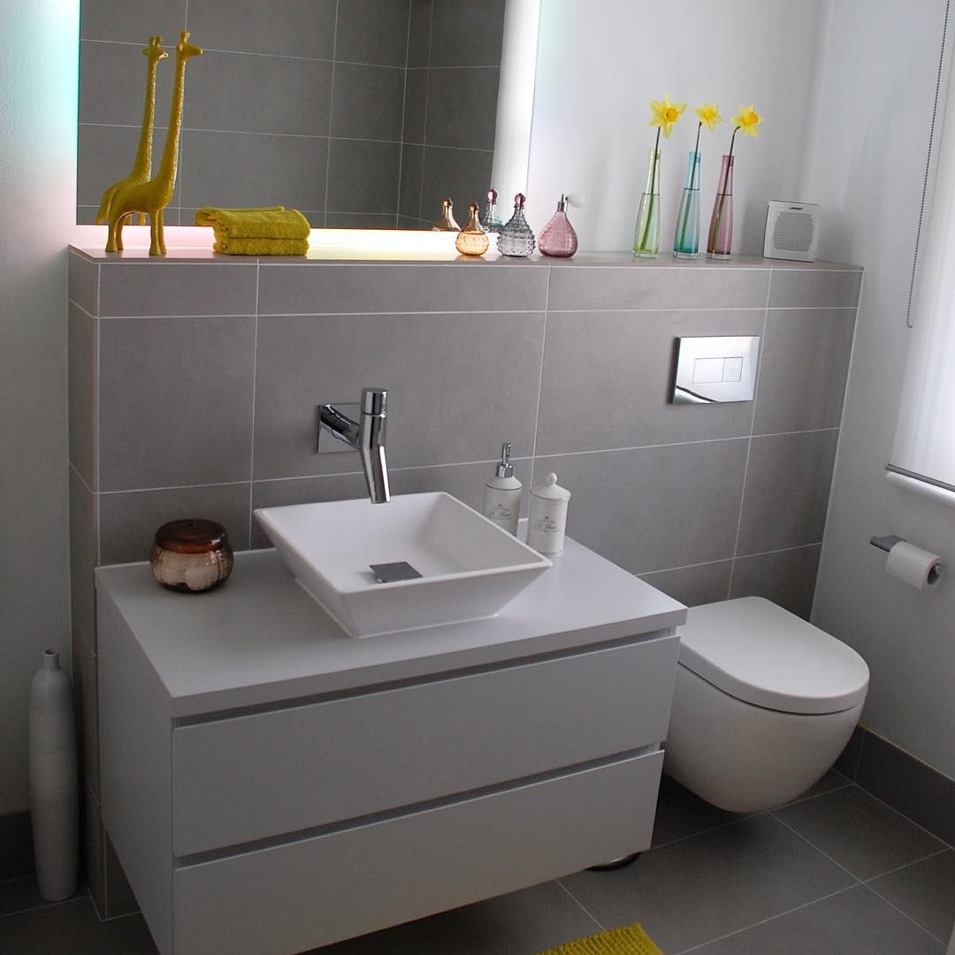 A Simple Modern Grey Bathroom With A Handle Less Faeber Vanity Furniture Unit And Matt White Stone Bathroom Vanity Units Best Bathroom Vanities Bathroom Units