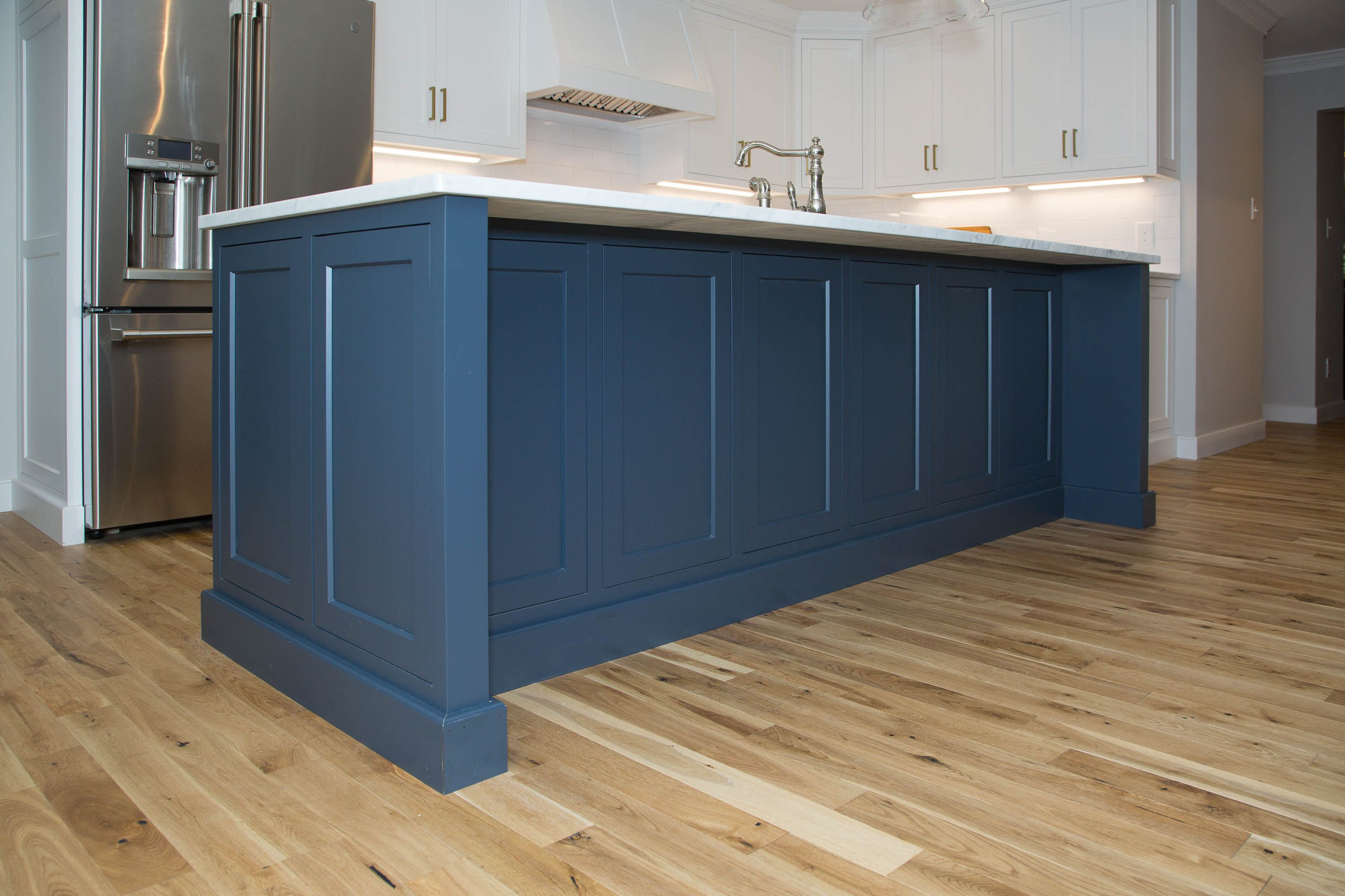 Navy Blue Island With White Kitchen Cabinetry Kitchen Cabinetry White Kitchen Home Decor