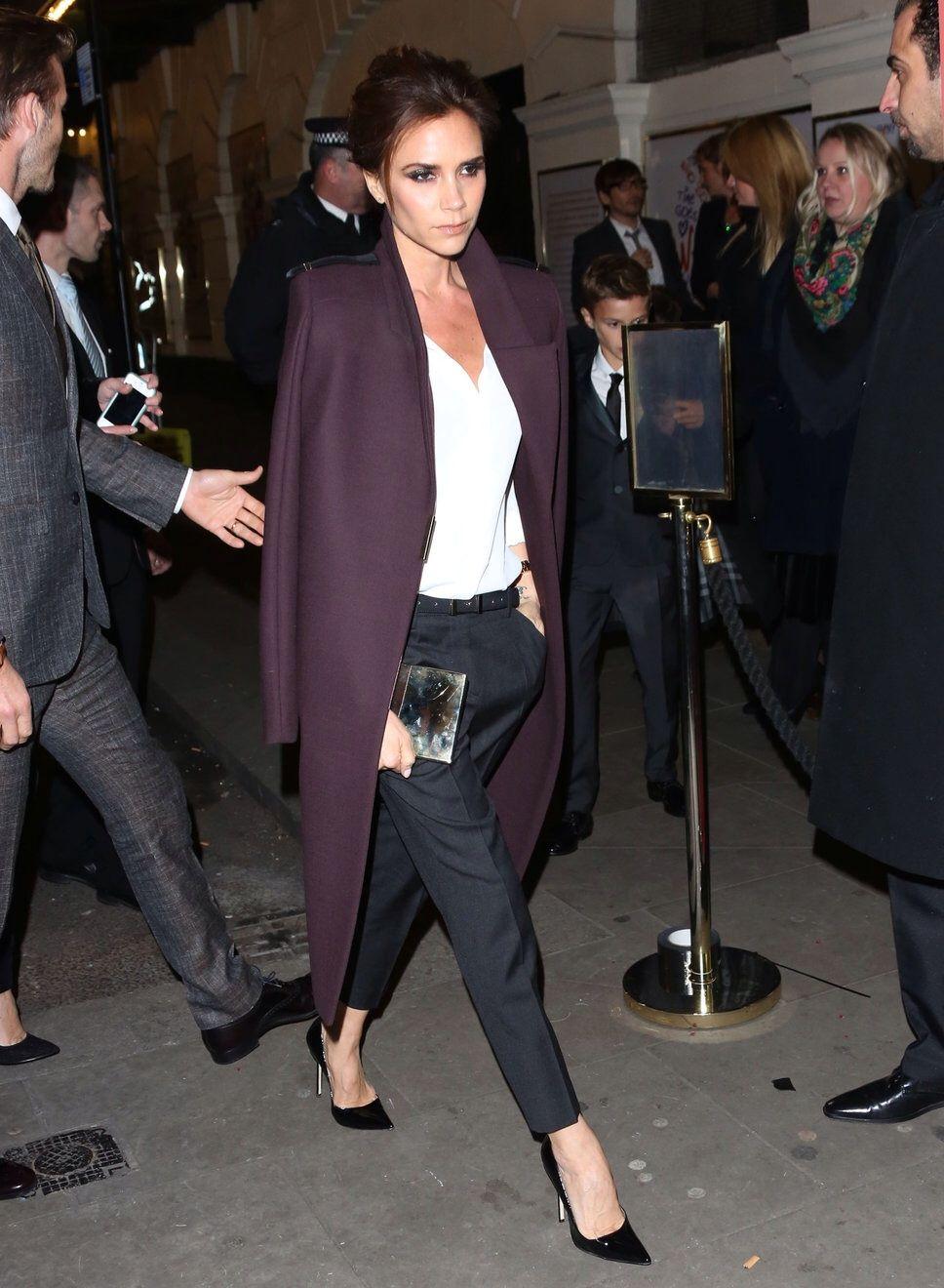 4b34e9047e Victoria Beckham wearing a burgundy coat