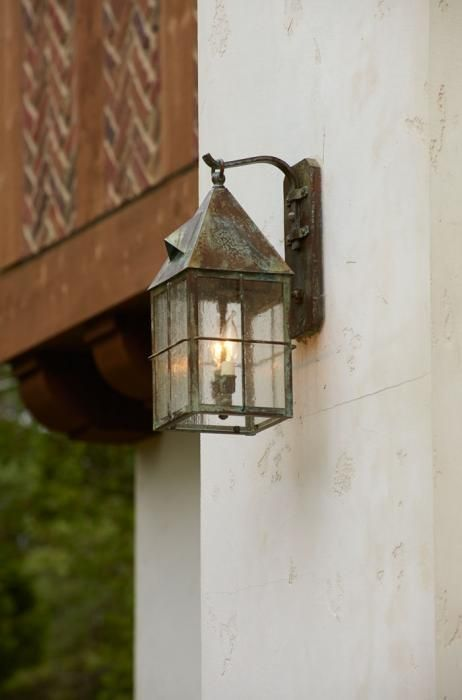 Nice Tudor Style Wall Lantern Hangs From The Side Of The House.