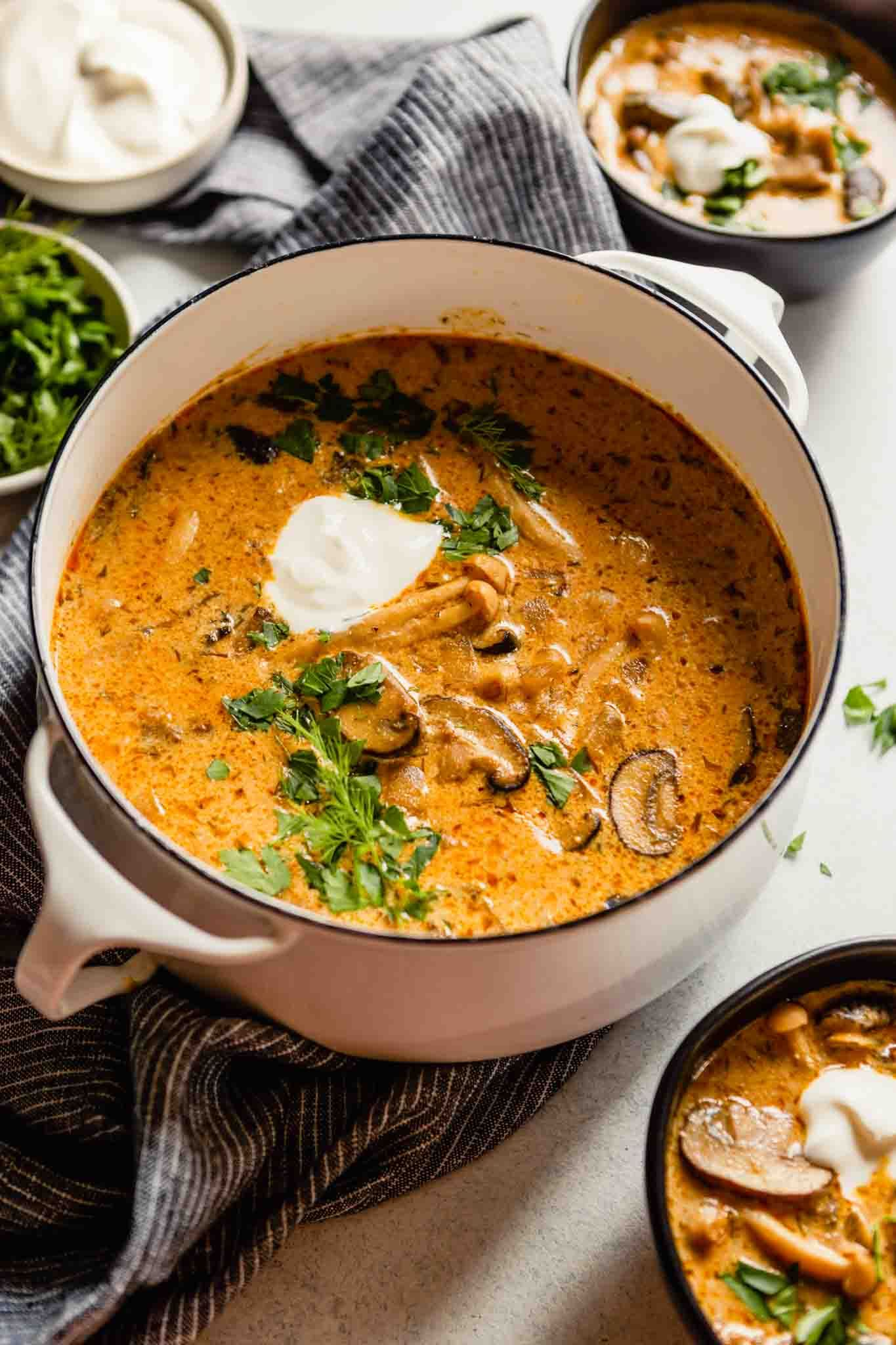 This Hungarian Mushroom Soup is full of flavor, creamy and so cozy. Among the mushrooms and dash of soy sauce—which add TONS of umami flavor—this soup is flavored with paprika, dill and sour cream. Serve with crusty bread for a soul-warming supper. | Zestful Kitchen #hungarianmushroomsoup #creamysoup #mushroomsoup #vegetariansoup #vegetarianmushroomsoup