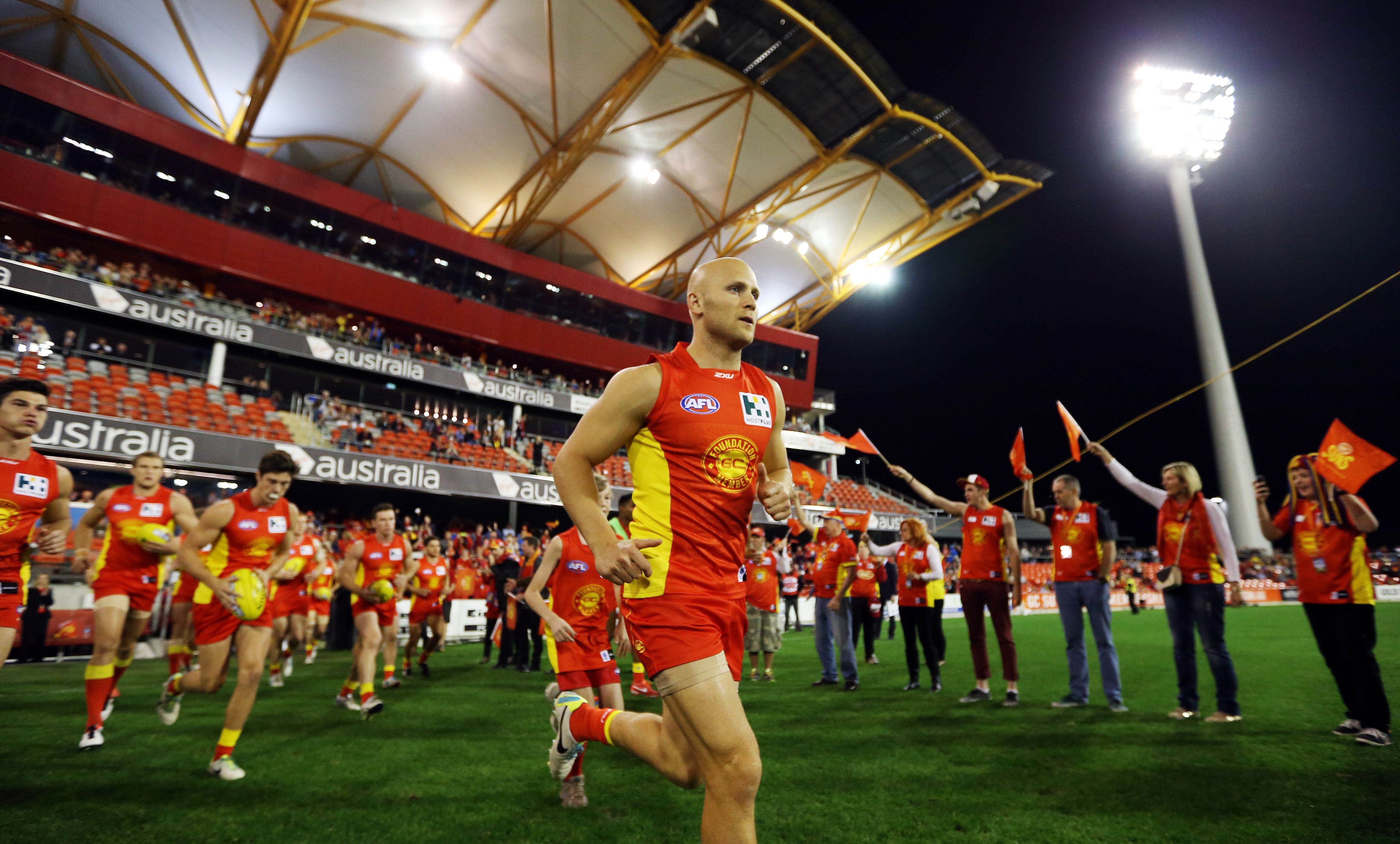 Skipper Gary Ablett leads his team out onto the field to