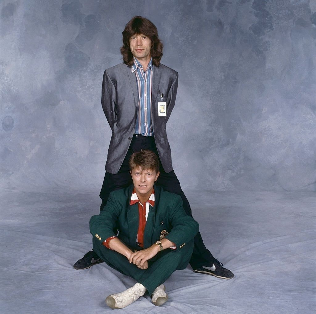 David Bowie and Mick Jagger pose together to mark the duet they will perform with an all-star band at at the Prince's Trust Concert, Wembley, 23rd June 1986; photo by Terry O'Neill