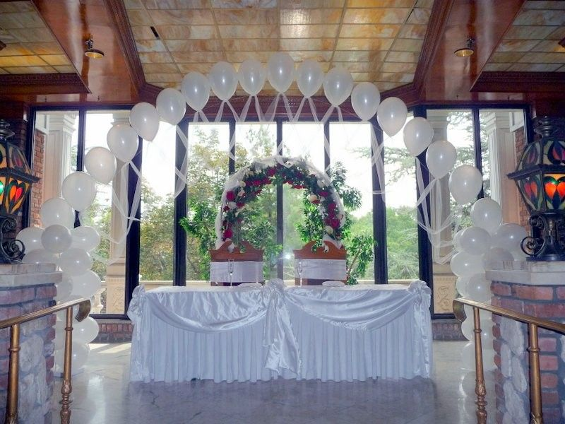 Wedding decoration ideas curved white indoor wedding ballon wedding decoration ideas curved white indoor wedding ballon decorations above long table and two wooden chairs also two lanterns create the sweet junglespirit Images