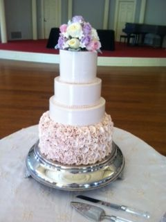 link pink buttercream with fondant pink ruffles and fresh floral topper www.weddingsbyholiday.com