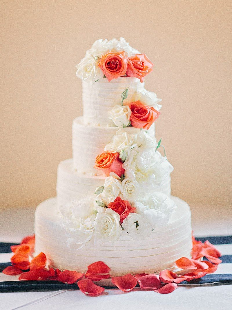 white and orange floral accented wedding cake! love it!