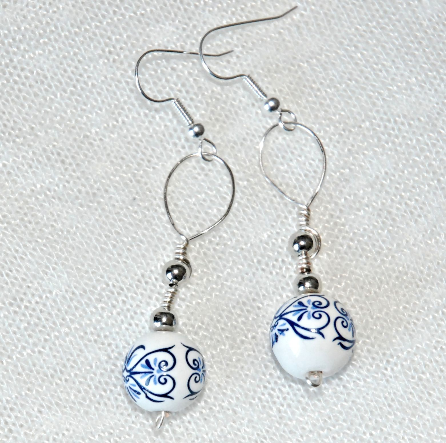 This is a pair of wire-wrapped earrings. The beads have a really ...