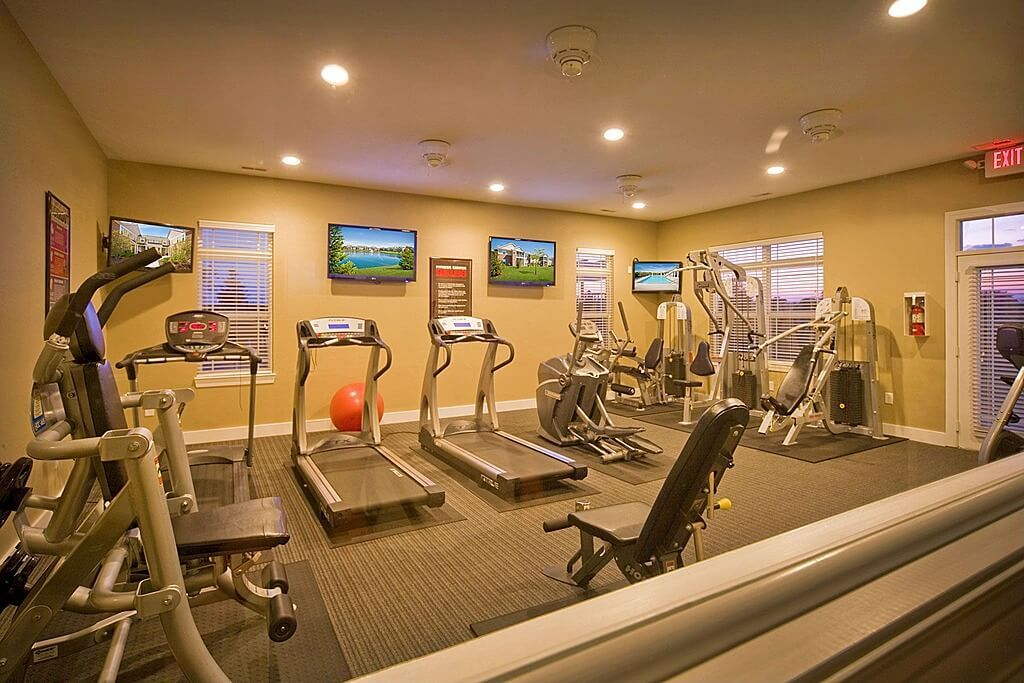 Superb Weight Room Design Ideas Part - 3: Large Cardio And Weight Machine Home Gym With Televisions On The Wall.