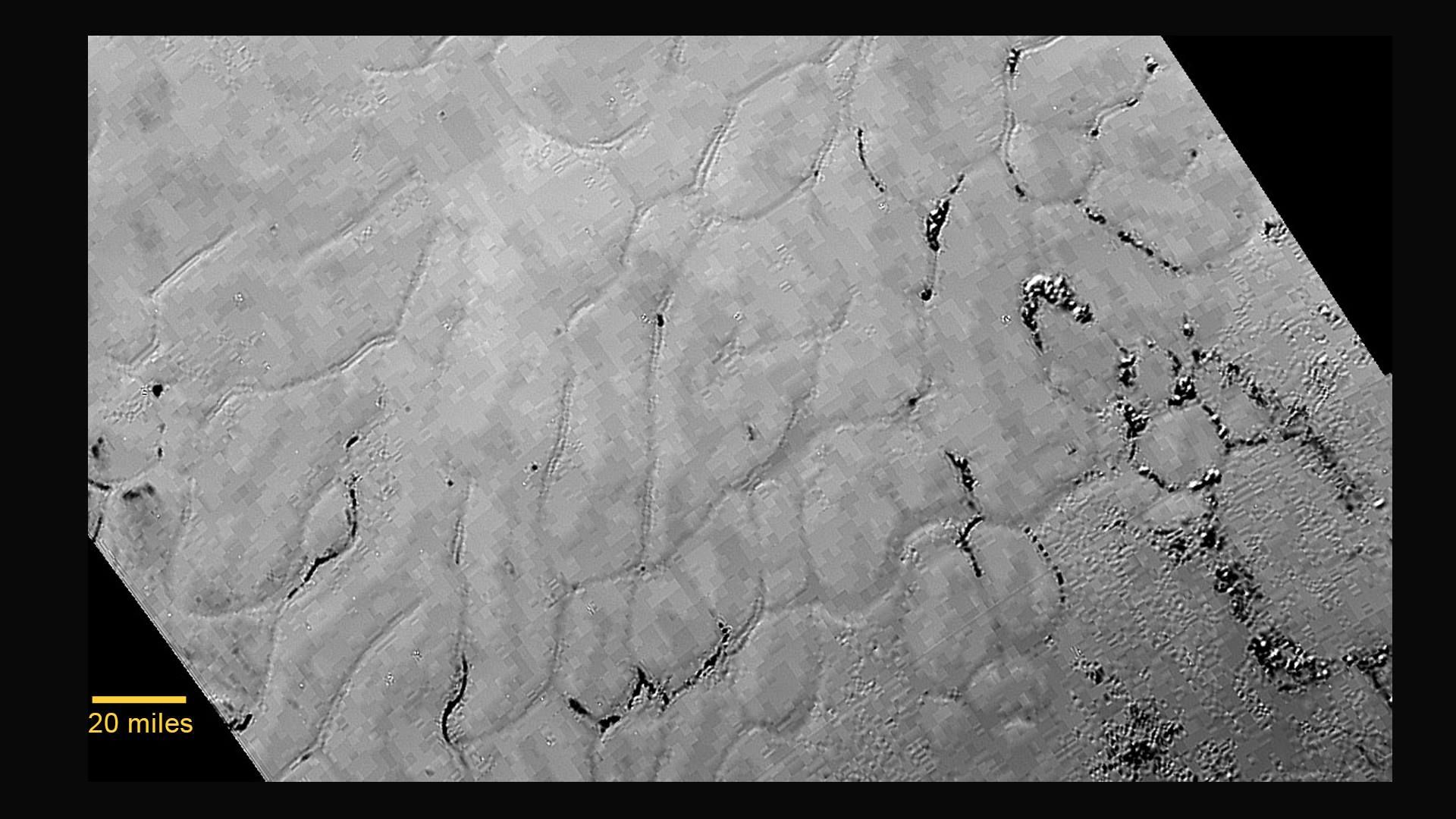 Frozen plains in the heart of Pluto's 'heart' discovered by New Horizons spacecraft! A new close-up image of Pluto reveals a vast, craterless plain that appears to be no more than 100 million years old, and is possibly still being shaped by geologic processes. This frozen region is north of Pluto's icy mountains, in the center-left of the heart feature.