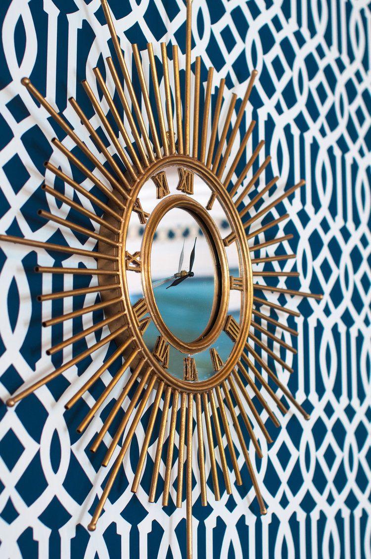 schumacher imperial trellis wallpaper & gold sunburst mirrored
