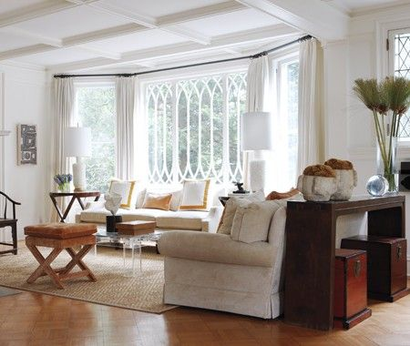Simple white drapes keep the focus on the gorgeous bay - Living room with bay window ...