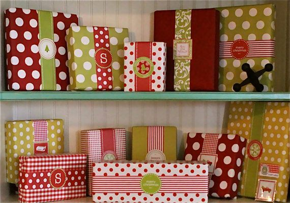 Oooo....I love this idea!  Paper ribbons!  I've never been that fond of big bows on Christmas presents.  They just get squished under the tree. :-)