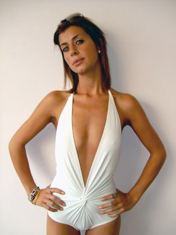 6bc4fd80e4910 Low V-neck one piece suit by Karla Colletto Swimwear at Pesca Trend. SEXY  SEXY! Plunging white V-neck one piece swimsuit with gorgeous cross over  center.