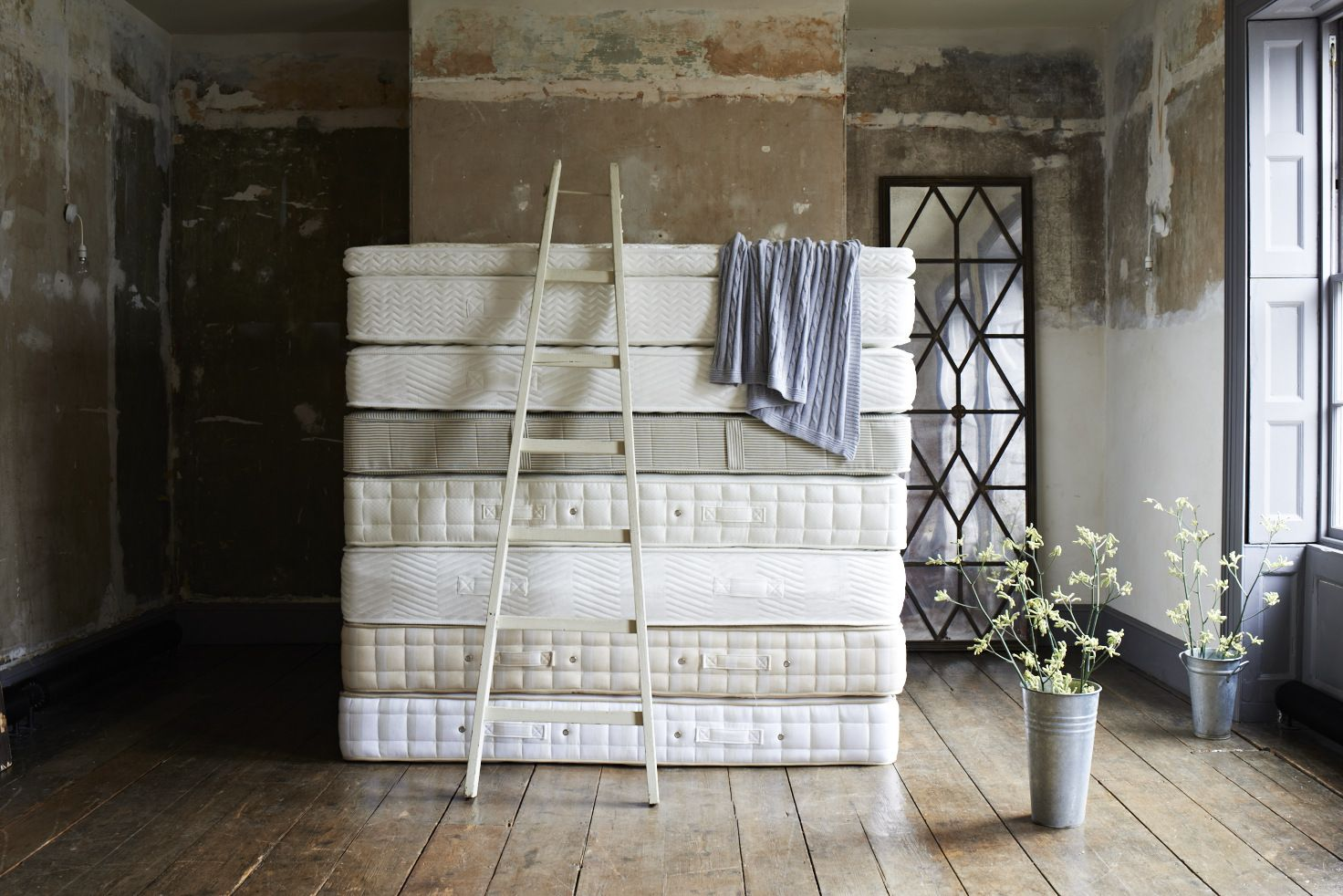 DAPW Mattresses featuring a cable knit throw Perfect