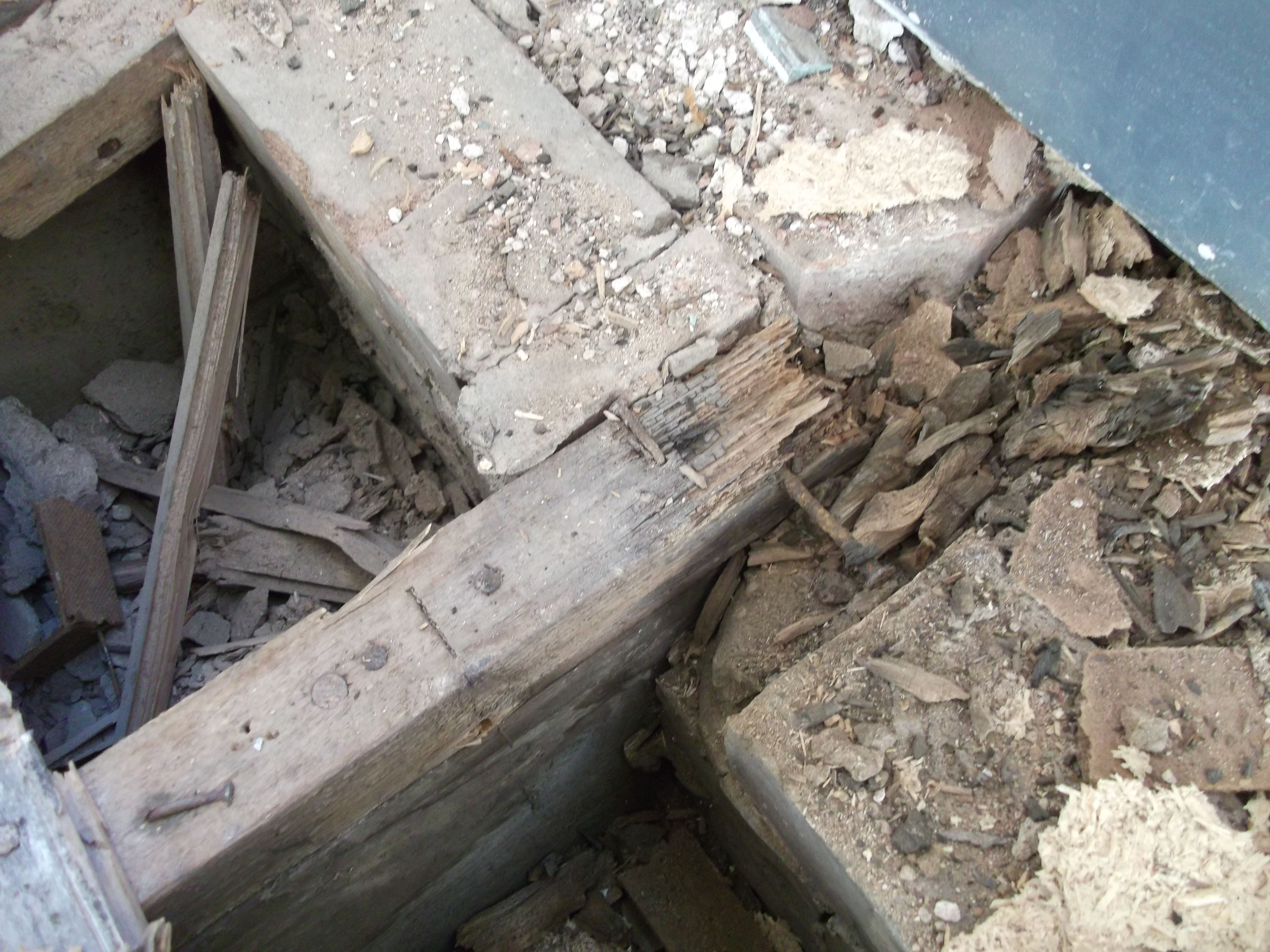 Dry Rot Image Showing Damage To Floor Joists And Floor Flooring