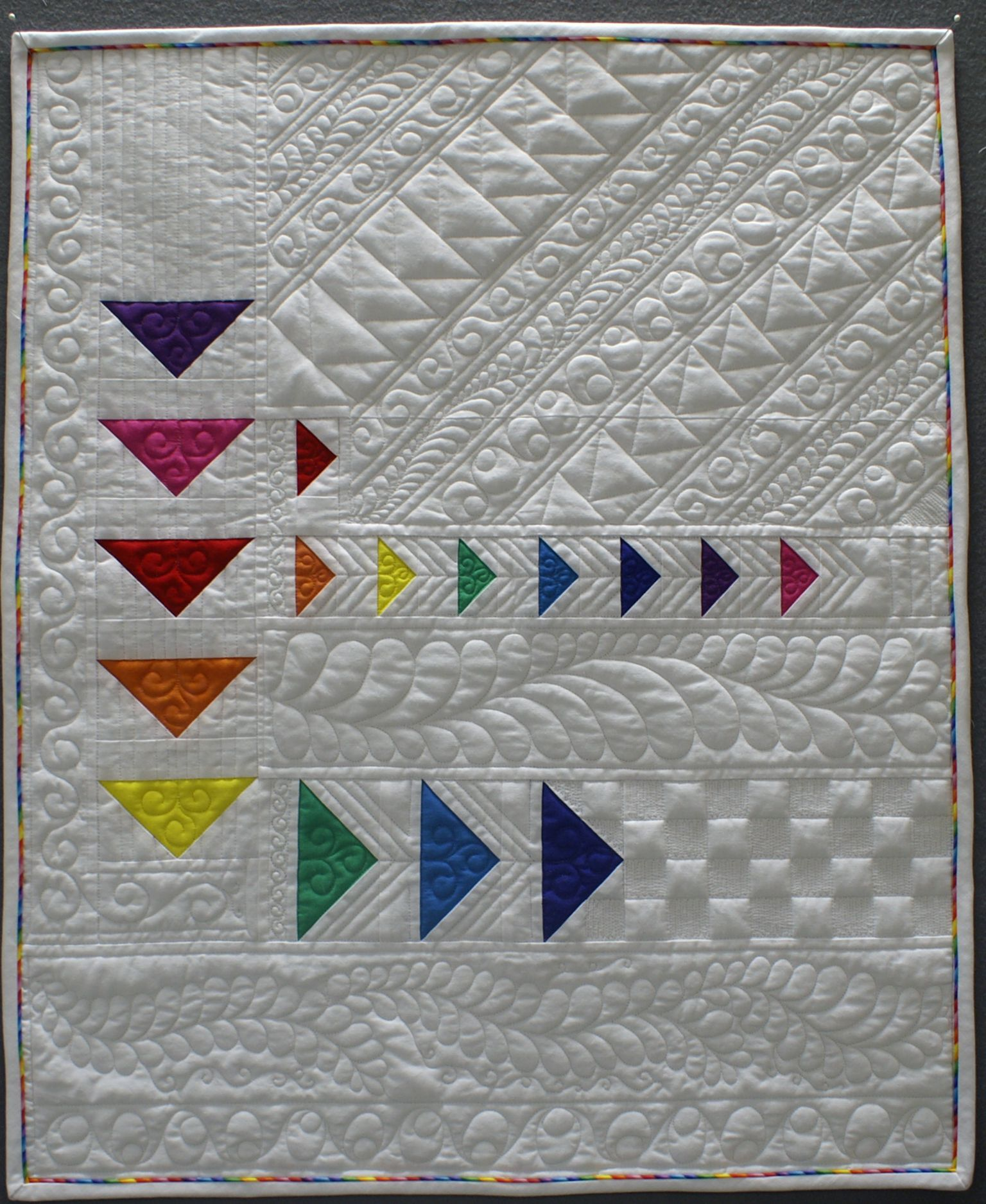 Rainbow flying geese quilt by Brenda Roach. Photo by The Quilt Journal. Rainbow quilts ...
