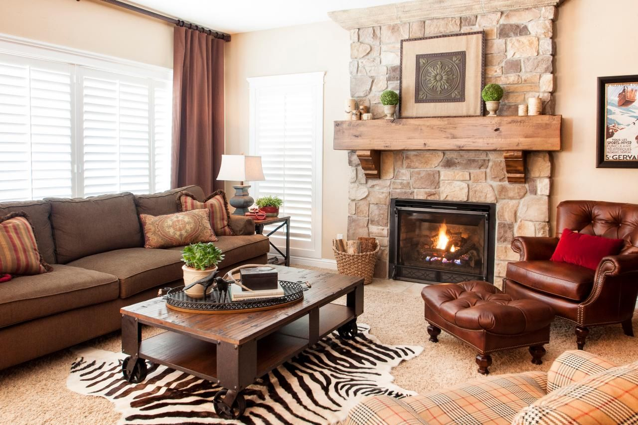 Rustic living room with stone fireplace and wood mantel living