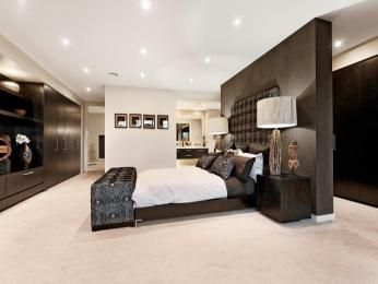 romantic bedroom design idea with timber built in wardrobe using brown colours bedroom