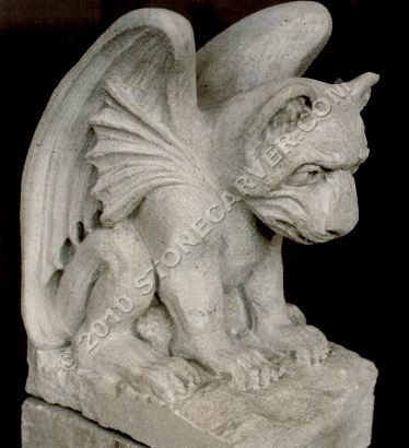 Solemn, this gargoyle resides under a cemetery bench, watching over ...