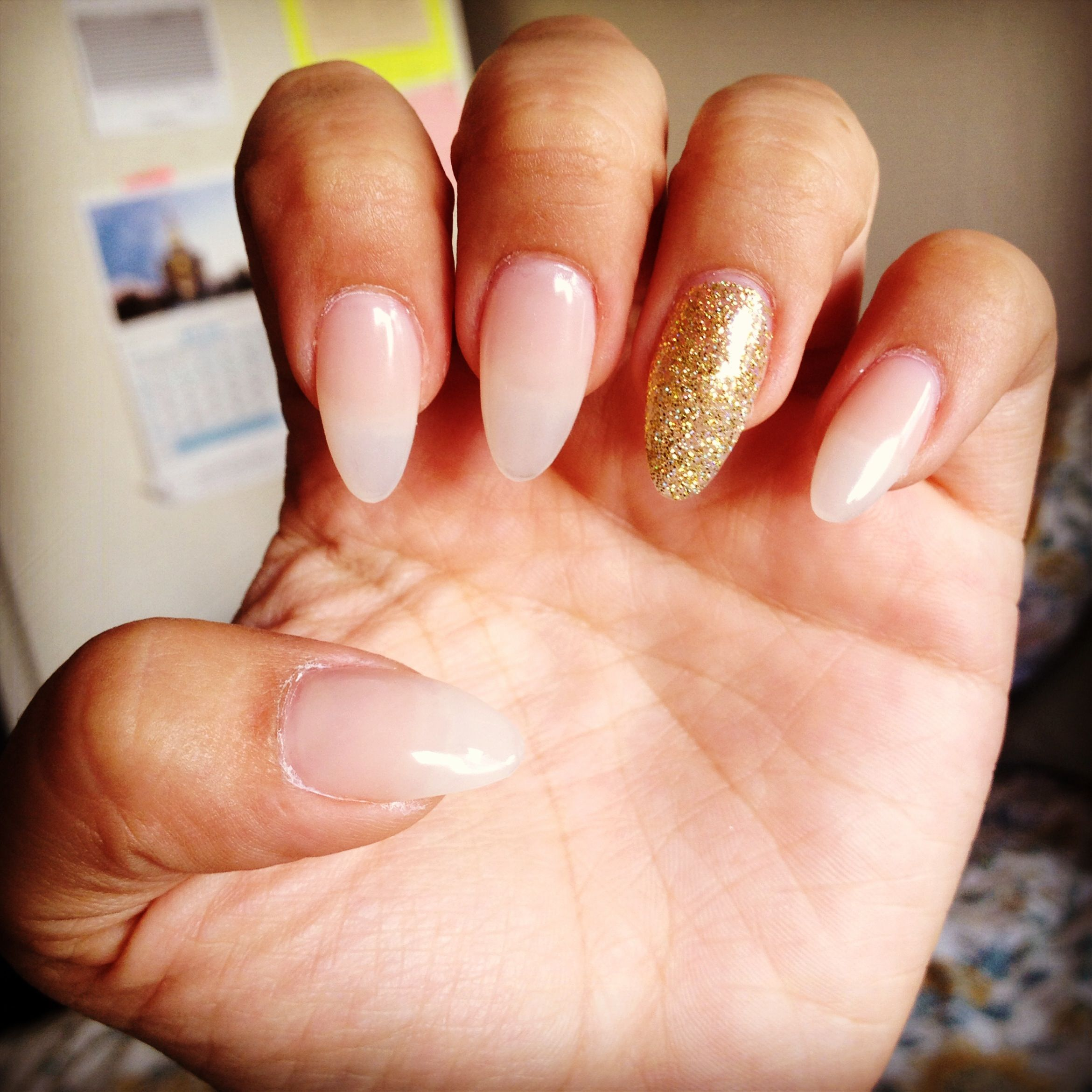 Almond Nails Pink With A Hint Of Gold Acrylic Glitter