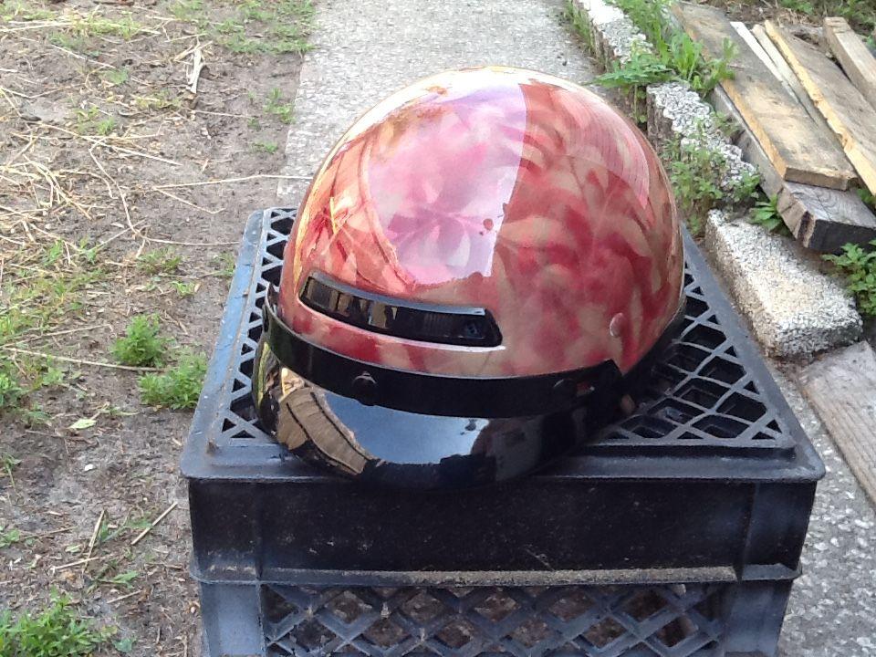 Custom motorcycle helmet I camouflaged for a customer .