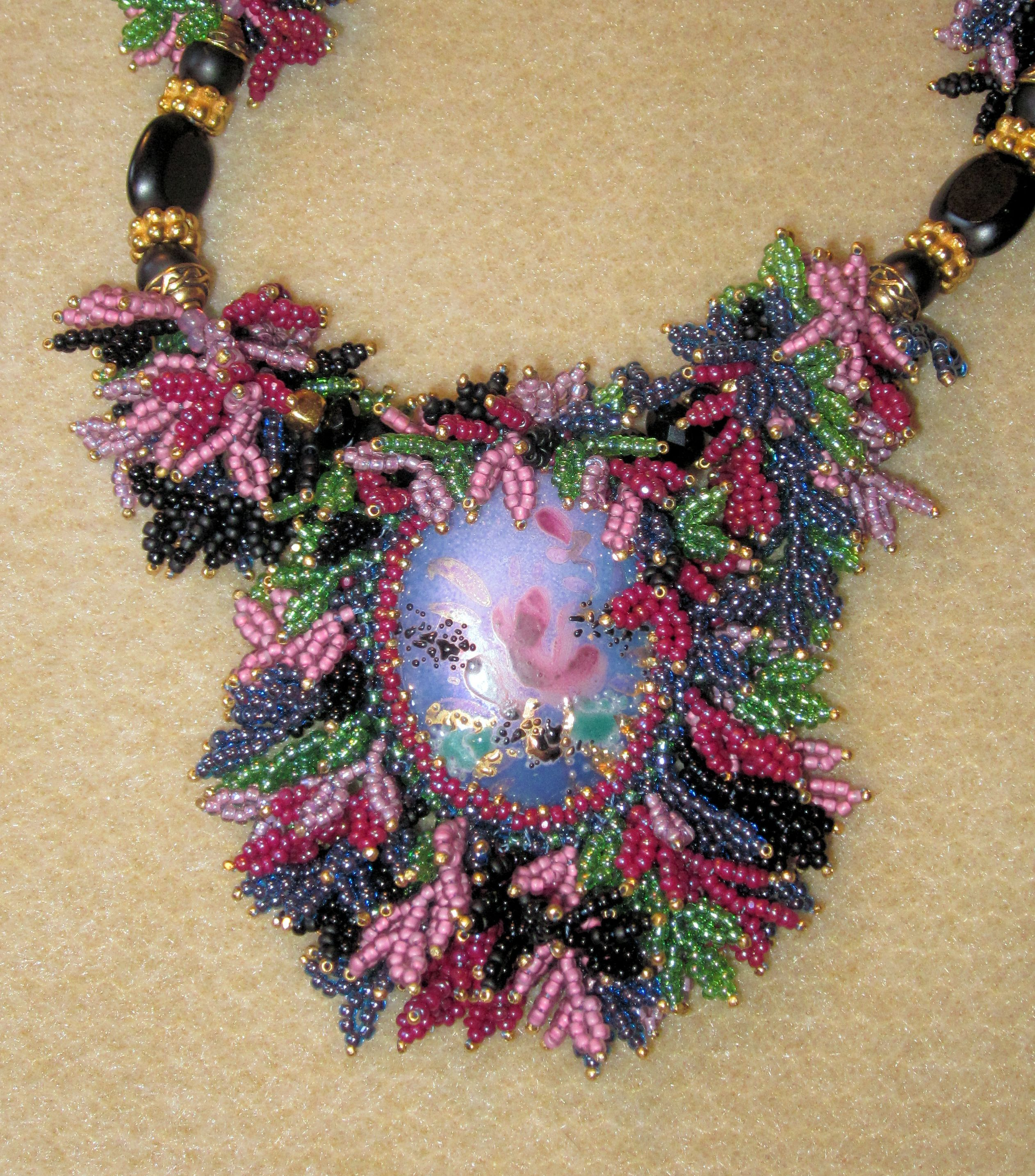 using the colors in the hand painted focal piece for the leaf fringing works wonderfully.   design 2005