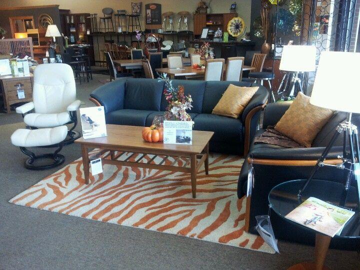 Ekornes Manhattan sofa and loveseat in Paloma black and cherry shown