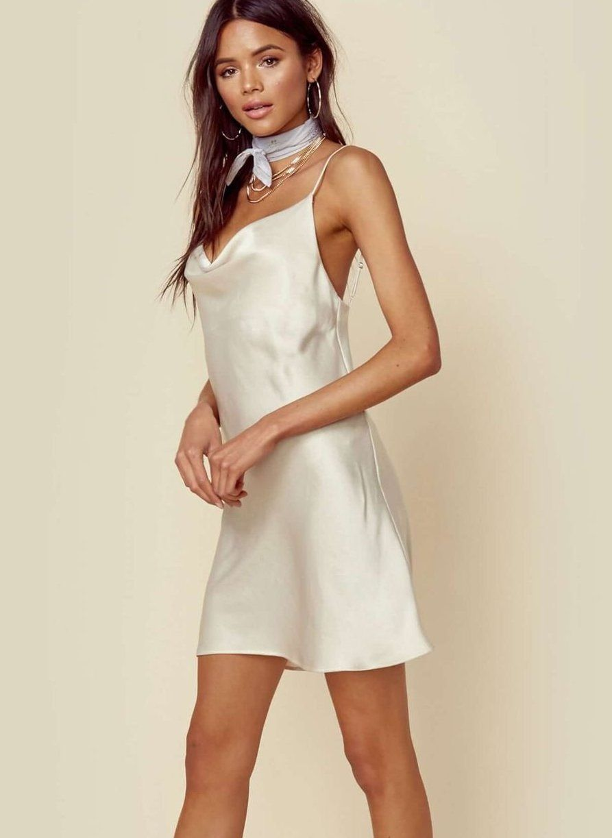 4b02a2bb769 Rock this slinky slip dress for your bachelorette party. See more white  dresses perfect for all your bachelorette festivities here.