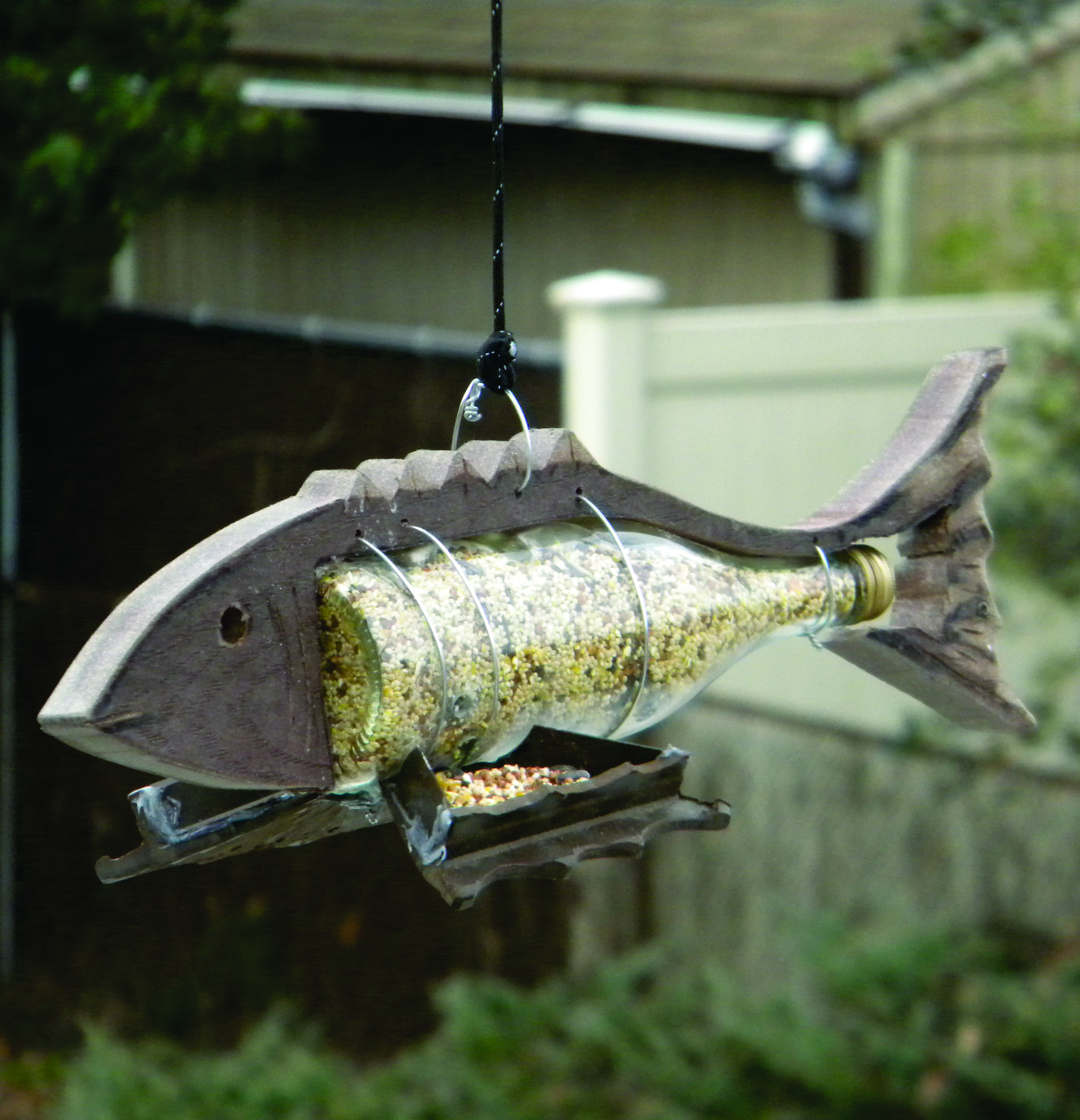 Diy nautical fish shaped wine bottle bird feeder www for How to make a bottle bird feeder